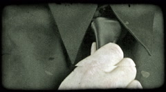 A close up of a hand straightening a tie. Vintage stylized video clip. Stock Footage