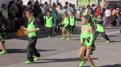 Group of children dancing on the streets of Banos for 100th anniversary of - stock footage