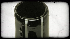 Vertical shot of rotating, black and white vase from top to botton. Vintage Stock Footage