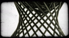 Design made of thin black rods, appears to be rotating. Vintage stylized video Stock Footage
