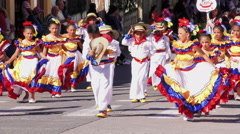 Group of childrens dressed up in traditional costumes dancing on the streets of Stock Footage
