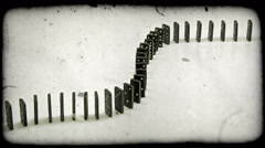 Shot of dominoes toppling on top of each other. Vintage stylized video clip. Stock Footage