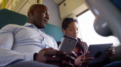 4K Attractive couple on train journey, pose for selfie with camera phone Stock Footage