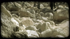 Couple hikes over rocks. Vintage stylized video clip. Stock Footage