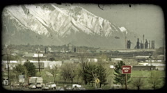 Busy city highways and mountains. Vintage stylized video clip. Stock Footage