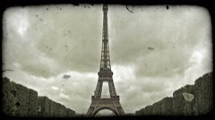 Front of Eiffel Tower. Vintage stylized video clip. Stock Footage