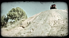 Jeep on rock hill 2. Vintage stylized video clip. Stock Footage
