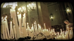 Stock Video Footage of Candles on Alter 3. Vintage stylized video clip.