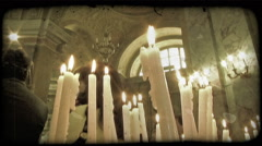 Stock Video Footage of Candles on Alter 4. Vintage stylized video clip.