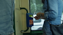 Woman do not know how to validate the ticket in the tram, steadycam shot Stock Footage