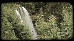 Scenic Hawaiian waterfall. Vintage stylized video clip. Stock Footage