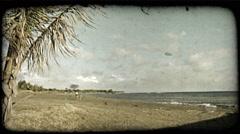 Quiet beach scene 1. Vintage stylized video clip. Stock Footage