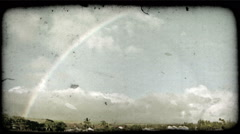 Rainbow over island town. Vintage stylized video clip. Stock Footage