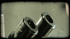 Man looks into microscope. Vintage stylized video clip. Stock Footage