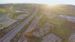 Aerial shot of modern interstate highway. Top view of fantastic green landscape Arkistovideo