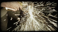 Man splices metal with a machine. Vintage stylized video clip. Stock Footage