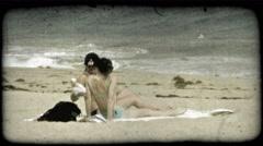 Women tan on beach. Vintage stylized video clip. Stock Footage