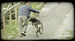 Man and Bike. Vintage stylized video clip. Stock Footage