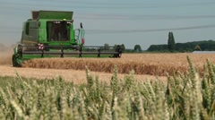 Combine harvester on a barley field in germany Stock Footage