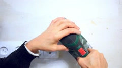 Plastering female hand sanding the plaster in white wall Stock Footage