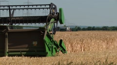 Combine harvester on a barley field in germany, July 2015 Stock Footage