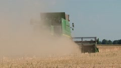 Combine harvester on a field in germany, harvesting barley Stock Footage