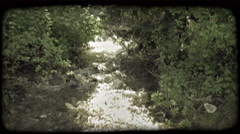 Mountain stream. Vintage stylized video clip. Stock Footage