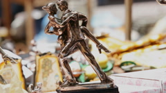 Dancing couple sculpture on flee market in Buenos Aires Argentina Stock Footage