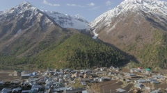 Chitkul village with snow capped mountains,Chitkul,Kinnaur,India Stock Footage