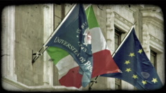 Static shot of flags on the facade of the University of Pisa building. Vintage Stock Footage