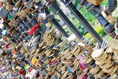 lot of wedding padlocks on bridge railings, love forever concept - stock photo