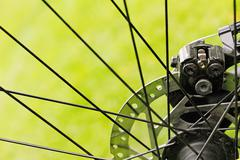 Close up of bicycle disc brakes on green grass background Kuvituskuvat
