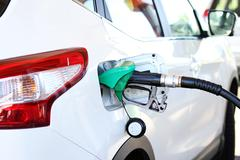 refilling the car with fuel in gas station - stock photo