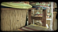 Tilting shot of different fabrics on shelves inside a shop. Vintage stylized Stock Footage