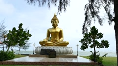 Large Buddha statue right by the sea of Khao Lak memorial park Stock Footage