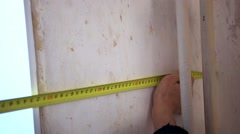 Worker hands measuring plaster wall for further wallpapering Stock Footage