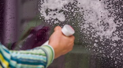 Human Hand Spraying Washing Foam On House Window Stock Footage