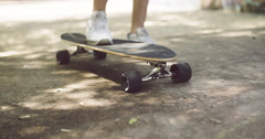 Feet of Man Skating on Longboard at the Street Stock Footage