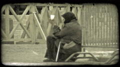 A begger woman. Vintage stylized video clip. Stock Footage