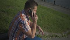 Man calling phone by the river Stock Footage