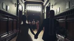 Newlyweds going in corridor slow motion Stock Footage