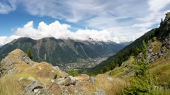 Skyrunner walks along a mountain trail. Sunny summer day. France Alps, Europe. Stock Footage