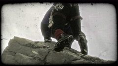 Mountain climber reaches peak. Vintage stylized video clip. Stock Footage