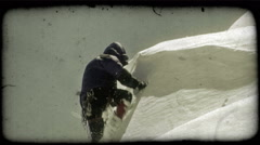 Man climbs up snowy hill. Vintage stylized video clip. Stock Footage