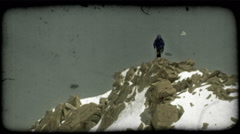 Climber overlooks terrain. Vintage stylized video clip. Stock Footage