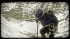 Mountain climber ascends mountain. Vintage stylized video clip. Stock Footage
