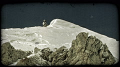 Man skis over ridge jump. Vintage stylized video clip. - stock footage