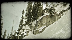 Man skis over cliff jump. Vintage stylized video clip. - stock footage