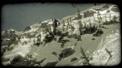 Skier skis over cliff jump. Vintage stylized video clip. - stock footage