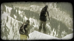 Stock Video Footage of Skiers begin trip down mountain. Vintage stylized video clip.